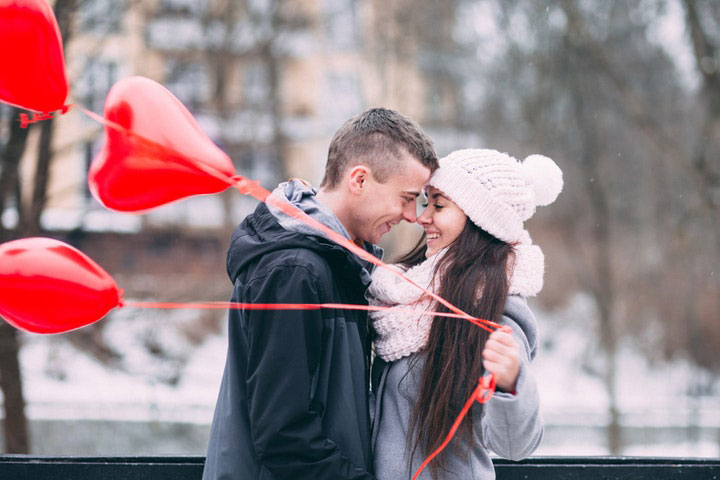 Lovers Getting Back Together Holding Heart Balloons